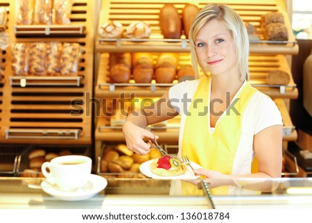 Bakery shopkeeper preparing coffee and cake for customer - stock photo