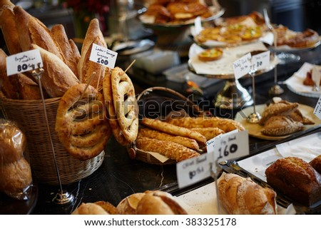 Bakery storage on the food market with bread, bun, and another grain meal products - stock photo
