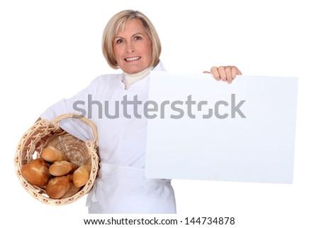 Bakery worker self-advertising - stock photo