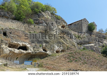 BAKHCHYSARAI, REPUBLIC OF CRIMEA, RUSSIA - AUG 12, 2014: Medieval cave city-fortress Chufut-Kale. Crimean Karaites Kenassas XVI and XVIII century - stock photo
