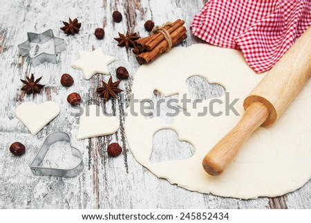 baking background - dough, cookie cutters and spices
