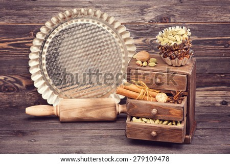 Baking background. rolling pin, spicy, and spices - stock photo