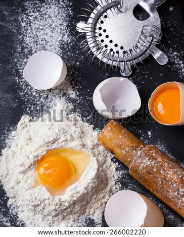 Baking background with eggshell,  flour and rolling pin .selective focus - stock photo