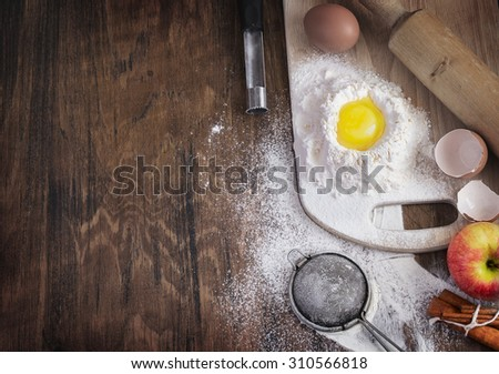 Baking background with raw egg, flour and apple, empty template - stock photo