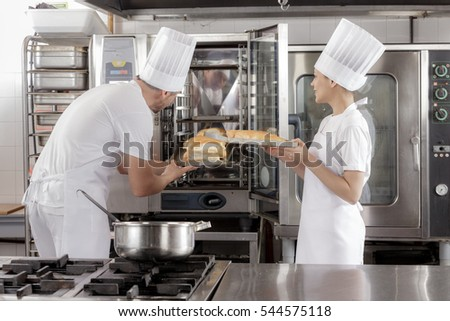 Restaurant Kitchen Oven industrial oven stock images, royalty-free images & vectors