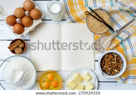 Baking cake in rural kitchen - dough recipe ingredients (eggs, flour, milk, butter, sugar) on white wooden table from above.  - stock photo
