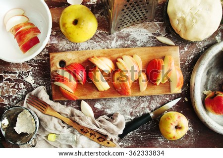 Baking cake ingredients - bowl, flour, eggs, egg whites foam, eggbeater and eggshells on black chalkboard from above. Cooking course or kitchen mess poster concept. - stock photo