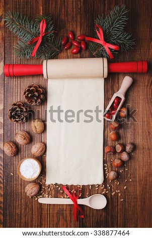 Baking Christmas cookies card. Christmas spices, cookie cutters, homemade dough and some ornament. - stock photo