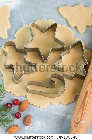 Baking Christmas cookies - dough on the table, cookie cutters and cookies. New year. Christmas