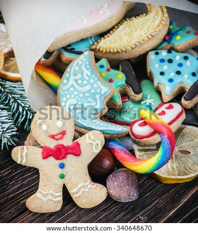 baking Christmas cookies on a wooden table - stock photo