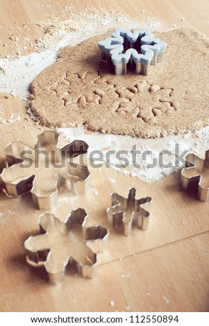Baking Christmas snowflakes cookies - stock photo