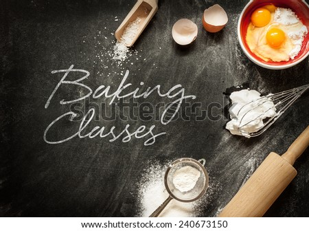 Baking classes poster design with cake ingredients on black chalkboard from above. Bowl, flour, eggs, egg whites foam, eggbeater, rolling pin and eggshells. - stock photo