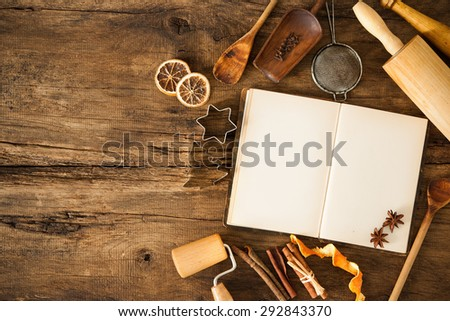 Baking concept background with cookbook, ingredients and utensils for Christmas cookies - stock photo