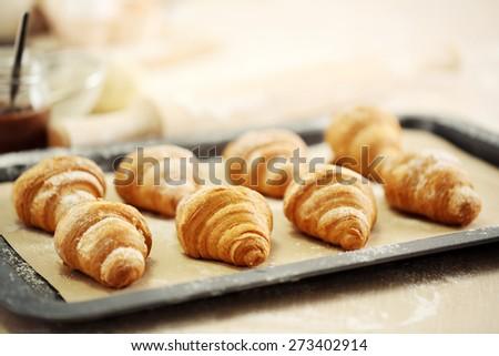 Baking croissant cookies.  - stock photo