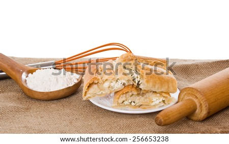 Baking from the exhaust test, whisk flour and rolling pin on sacking - stock photo