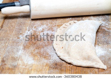 Baking homemade calzones with a large depth of field
