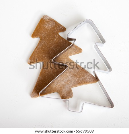 Baking homemade Gingerbread cookies with a shape of a christmas tree - stock photo