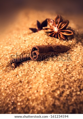 Baking ingredients Cinnamon sticks,  star anise and cane brown sugar. Winter Christmas spices macro. - stock photo