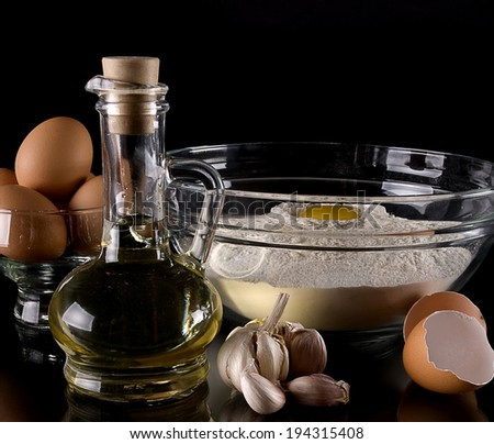Baking ingredients eggs, flour and oil  - stock photo