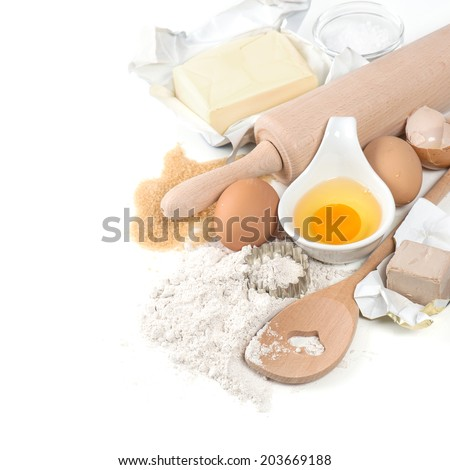 baking ingredients eggs, flour, sugar, butter, yeast. dough preparation - stock photo