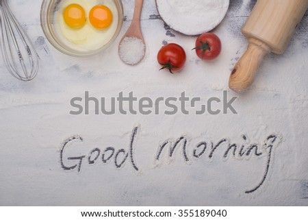 baking ingredients eggs, flour, sugar, butter, yeast. dough preparation. food background - stock photo