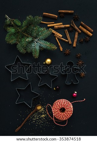Baking ingredients for Christmas holiday traditional gingerbread cookies preparation, black background, top view - stock photo
