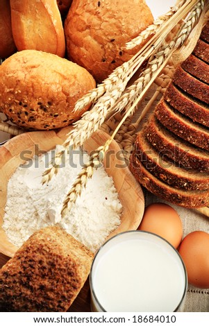 Baking ingredients, milk, and pastry isolated on white background - stock photo