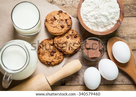 Baking ingredients on a wooden board, horizontal, top view, close-up - stock photo