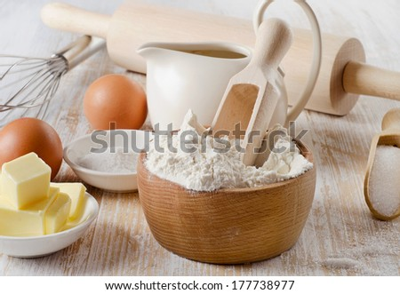 baking ingredients on a wooden table . Selective focus