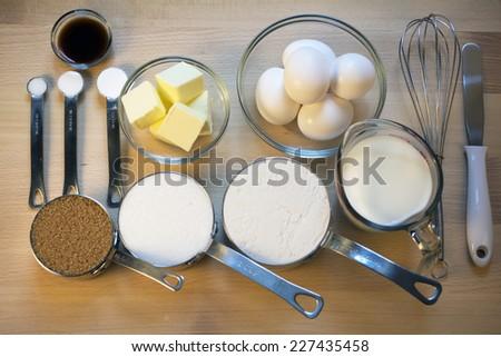 Baking Ingredients on Wooden Board - stock photo