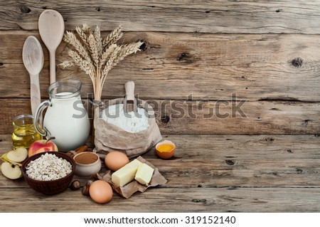 baking ingredients or cooking apple pie eggs, flour, wheat, sunflower oil, butter, cinnamon, milk, apples, yeast. food background. Free space for text. Copy space. Top view - stock photo