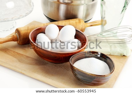 Baking ingredients, sugar, and eggs with other ingredients
