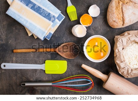 Baking Kitchen Utensils On Vintage Planked Wood Table From Above - stock photo
