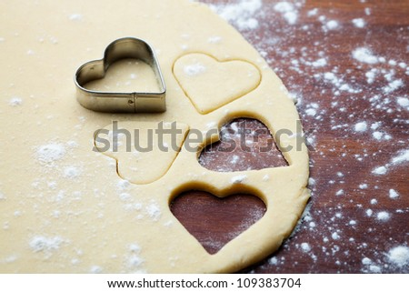 Baking love cookies for Valentine�´s Day - stock photo