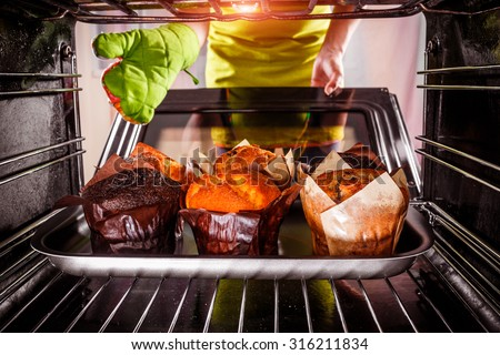 Baking muffins in the oven, view from the inside of the oven. Cooking in the oven. - stock photo