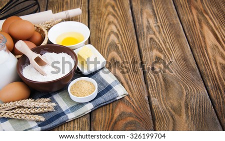 Baking preparation, a variety of baking utensils and ingredients - stock photo