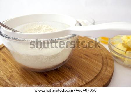Baking Preparation with Flour ready to be sieved with other ingredients in the background