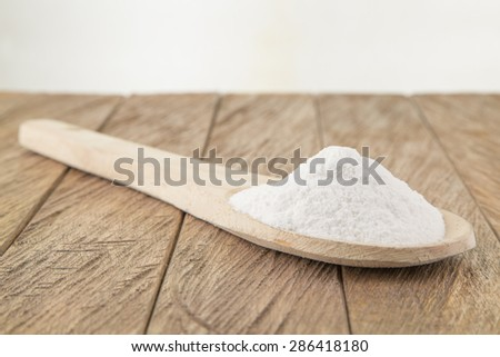 baking soda (sodium bicarbonate) in a wooden spoon - stock photo