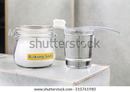 Baking soda used to brighten teeth and remove plague from gums - stock photo