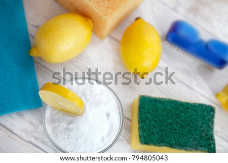 Baking soda with lemon and cleaning brush on the table. Top view.