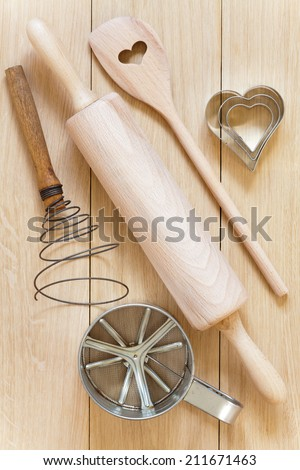 Baking utensils made �¢??�¢??of wood lying on a wooden table