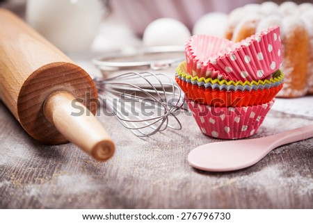 Baking utensils with cupcake cases - stock photo