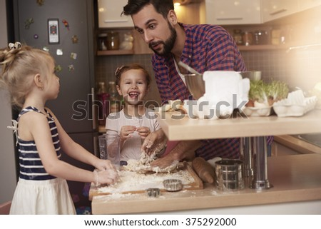 Baking with dad is so funny  - stock photo