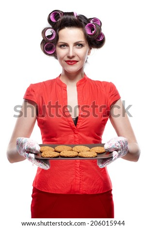 baking woman showing cookies on oven tray. - stock photo