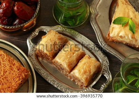 Baklava, turkish traditional delight with fresh mint and figs.