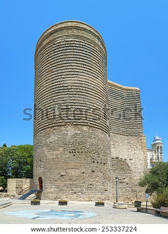 BAKU, AZERBAIJAN - AUGUST 23, 2014: Maiden Tower in the Baku Old City. The Maiden Tower built in the 12th century is one of the most noted landmarks and Azerbaijan's most distinctive national emblems. - stock photo
