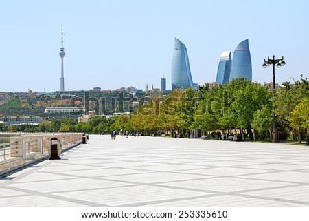 BAKU, AZERBAIJAN - AUGUST 23, 2014: View of Flame Towers skyscrapers and TV tower from Caspian Sea Embankment. Flame Towers, opened in 2013, is the tallest skyscrapers in Baku with a height of 190 m. - stock photo