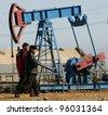 BAKU - AZERBAIJAN - FEB. 4: A roughneck maintains a drilling rig at a producing oil field near Baku, Azerbaijan, on Wednesday, February 4, 2009. - stock photo