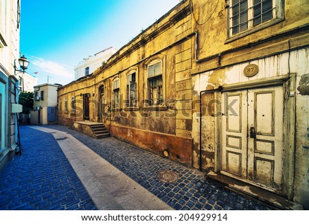 BAKU, AZERBAIJAN - June 12: Icheri Sheher (Old Town) of Baku, wide angle view lens. Azerbaijan, on June 12, 2014. Icheri Sheher is a UNESCO World Heritage Site since 2000.  - stock photo