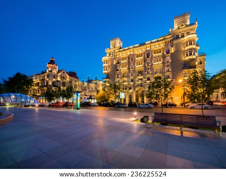 Baku - MAY 5, 2014: Illuminated building in the city center on May 5 in Azerbaijan, Baku. Baku is becoming a popular tourist destination - stock photo